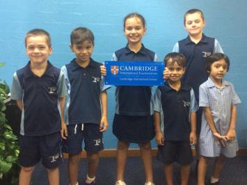 Larrakeyah Primary School students holding Cambridge sign